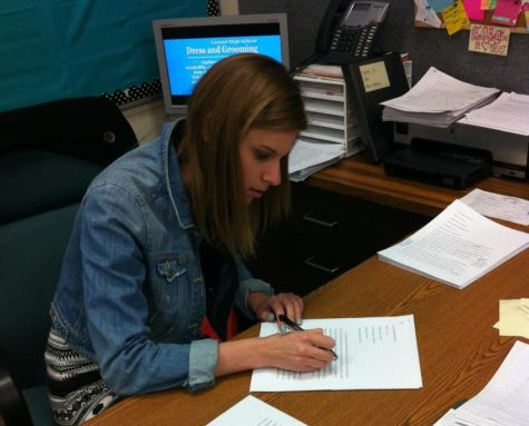 "CHTV sponsor Anna Kaiser edits the morning announcements scripts. Kaiser oversees the production of the announcements and teaches the broadcasting class. ""In our recent conference, we got first in music video and placed in several categories. Kaiser said. NATALIA CHAUDHRY/PHOTO"
