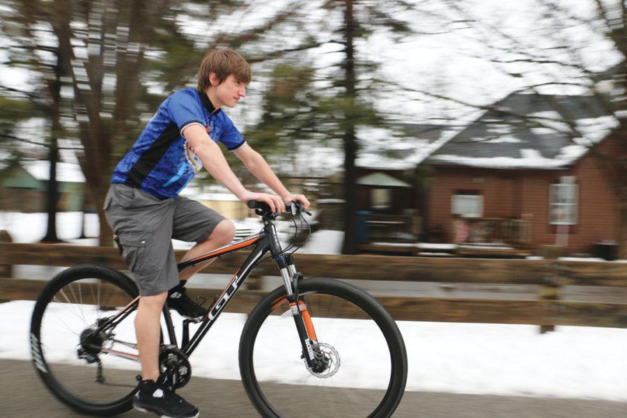 Walt Buschbacher, recreational biker and junior, rides his bike on the Monon Trail. Buschbacher said he hopes Carmel's new bike-share program will encourage more people to ride bikes. ALEX YOM / PHOTO