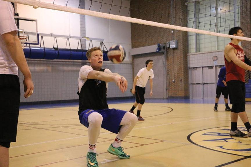 Jack Stanton, right side hitter and senior, sets a ball up for a teammate during practice. Stanton has been a part of the team for four years. PHOTO / MIKE JOHNSON