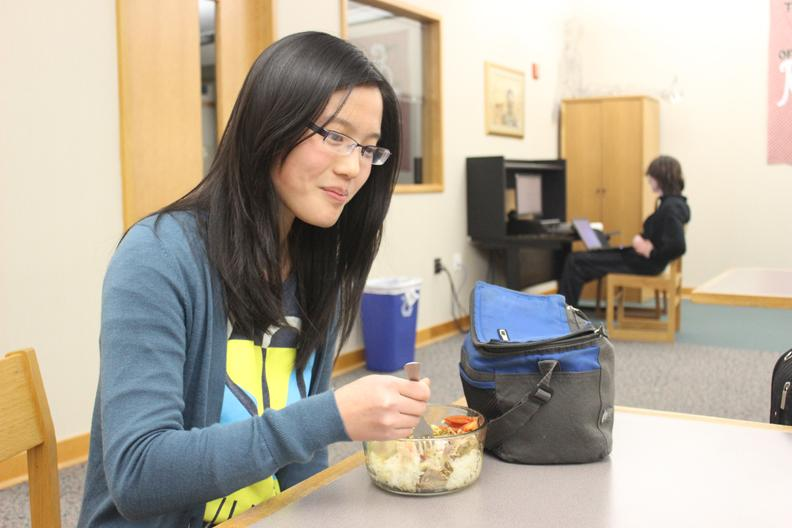 Junior Olivia Wang eats during her lunch period. She said she thinks that the new guidelines may cause some confusion in regards to eating habits. LEVY / PHOTO