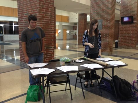 Member and senior Blake Lazerov and member and junior Erica Toomey stand outside the auditorium to hand out pledge forms to not text and drive. Guest speaker Kira Hudson spoke to the Sophomore Class on March 30 for Pre-Spring Break Awareness Week.