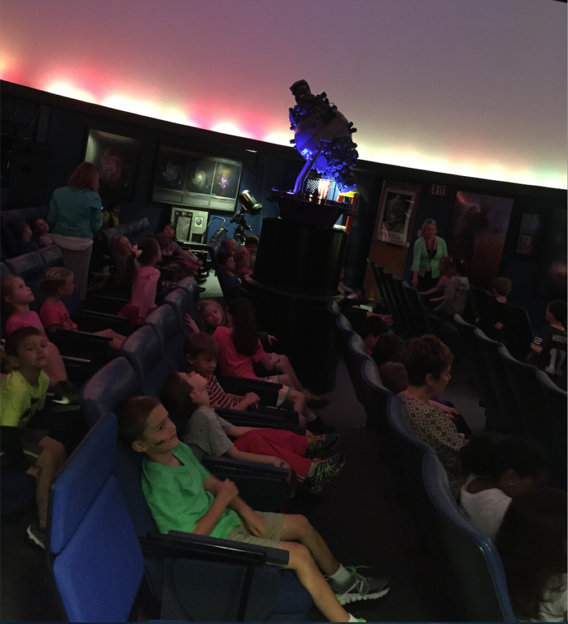 Kids watch a show put on by the Planetarium Club. According to Keith Turner, planetarium director and club sponsor, there are three different shows for the kids. ADAM GOSTOMELSKY/PHOTO