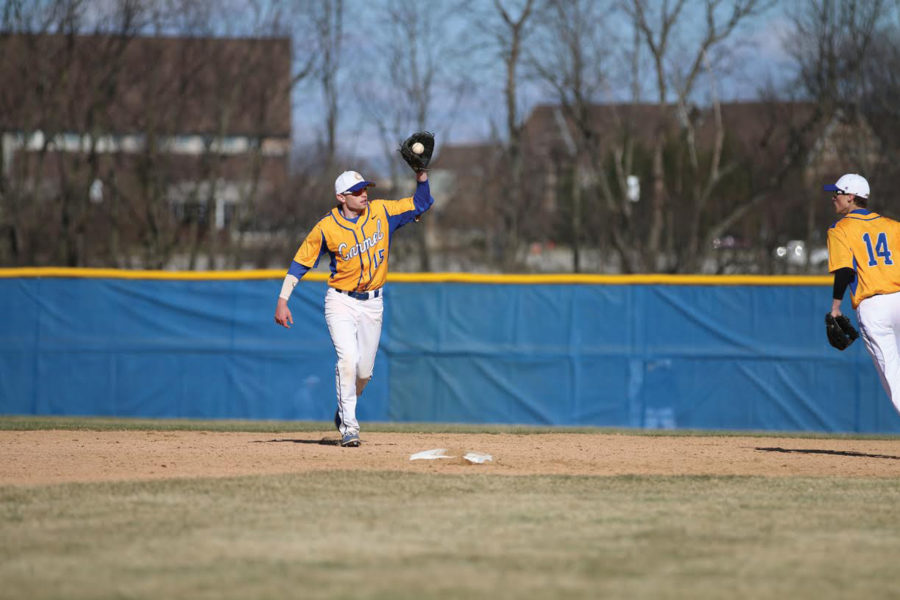 Elliot Shebek, senior and baseball player catches a ball in the warm up. Shebek has committed for baseball to DePauw University.