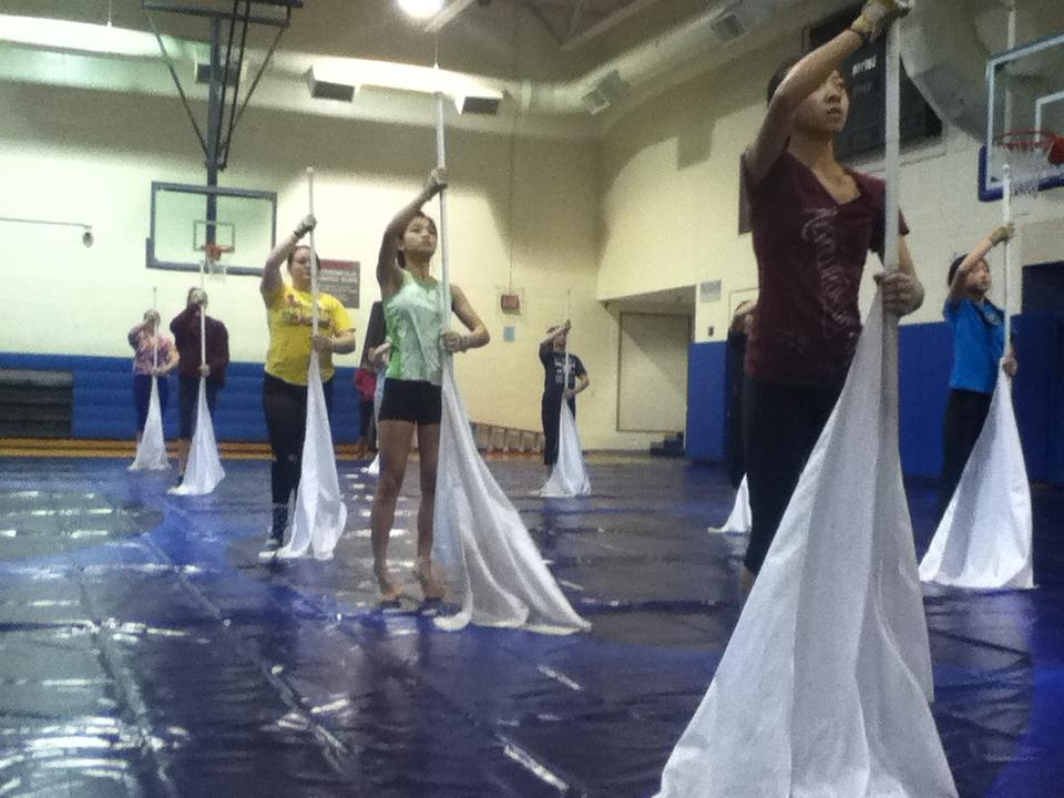 Color Guard members stand in position during their morning practice. They will be performing in the WGI World Championships in mid-April.
