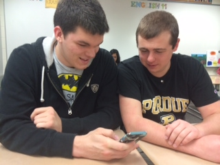 Senior Matthew Deaton talks with his friend in class. According to Deaton, the CCPL does a good job catering to teens' needs.