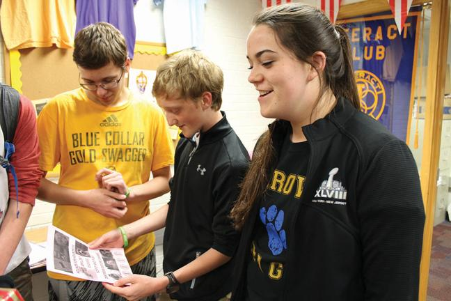 During a meeting, Natalie Cotherman, Interact Club member and sophomore, discusses ideas and organization for the Hounds for Hounds event. Members will host Hounds for Hounds on Tuesday in the freshman cafeteria. SWETHA NAKSHATRI / PHOTO