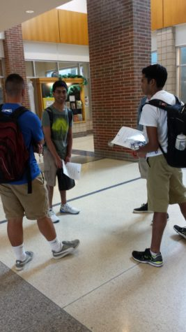 Gupta talks with friends after an AP exam. Gupta may take over as president of ISA next year, but it is still undecided.