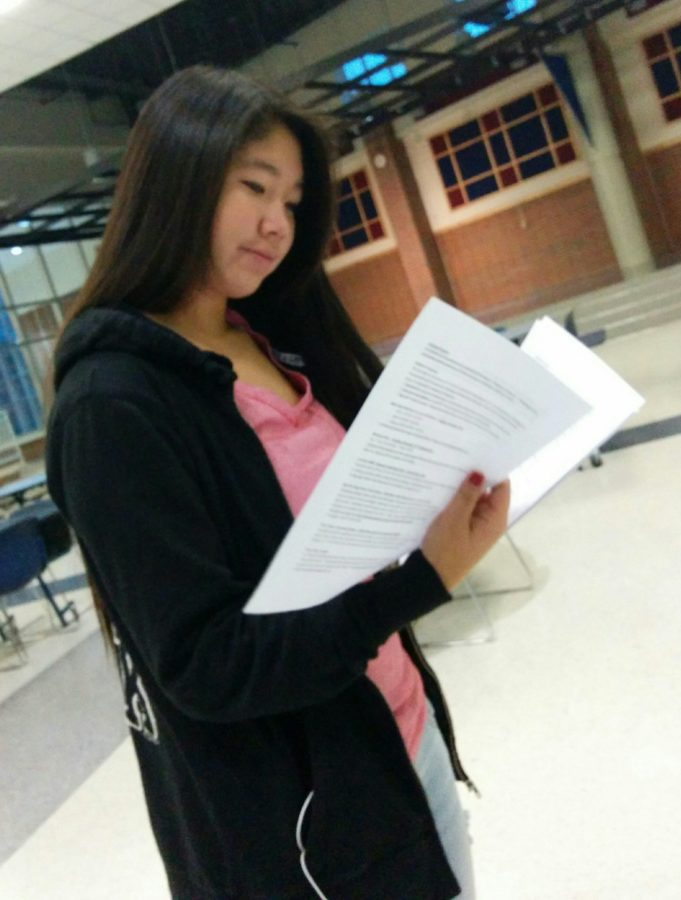 Secretary and sophomore Cynthia Cahya reads volunteer events available for club members to get hours. Volunteer hours are due May 15. They can be turned in outside Rooms E232 and H206. MELISSA YAP / PHOTO