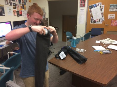Junior Jake Patterson prepares for class. According to Patterson, teens should get involved in the CCPL.