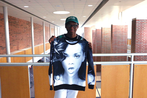 THE RIHANNA EFFECT: Tyler McDuffy, Hollywood Hounds anchor and junior, holds a shirt of Rihanna. McDuffy said the media affects how he expresses himself. DIVYA ANNAMALAI / PHOTO