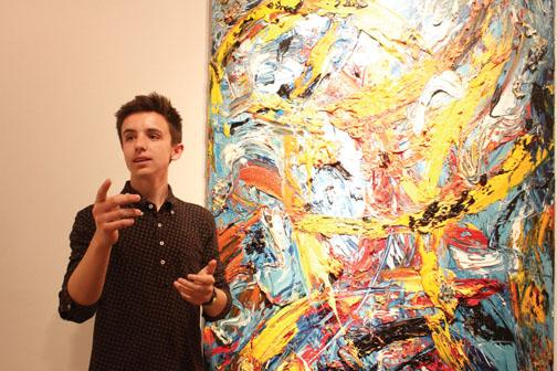 Sophomore Ethan McAndrews presents a piece of artwork in the Carmel Arts Council's Children's Art Gallery. This summer, McAndrews will participate in the Emerging Curators Program, which he said complements his interests in art.