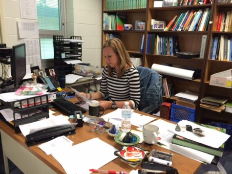Michelle Foutz, Economics Club sponsor and economics teacher, sits at her desk, checking her email. She said her hopes for the club include going to New York