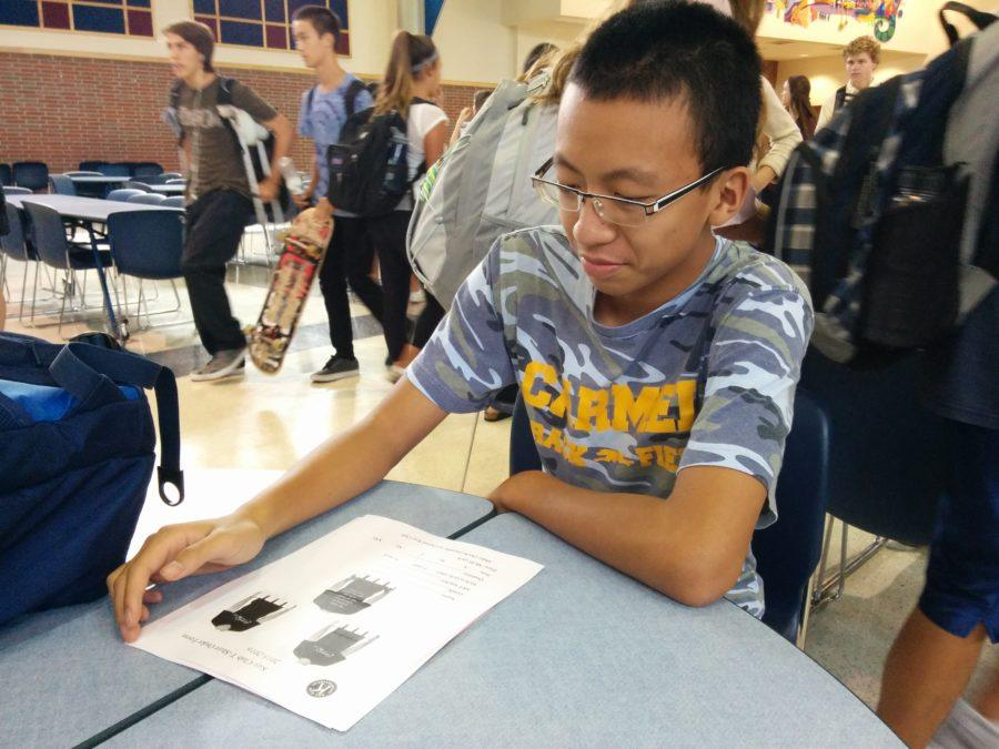 Kevin Zhangchen, Key Club member and junior, fills out a club t-shirt order form. T-shirts are available for $8, and students can pick up order forms from rooms A222 and E229.
