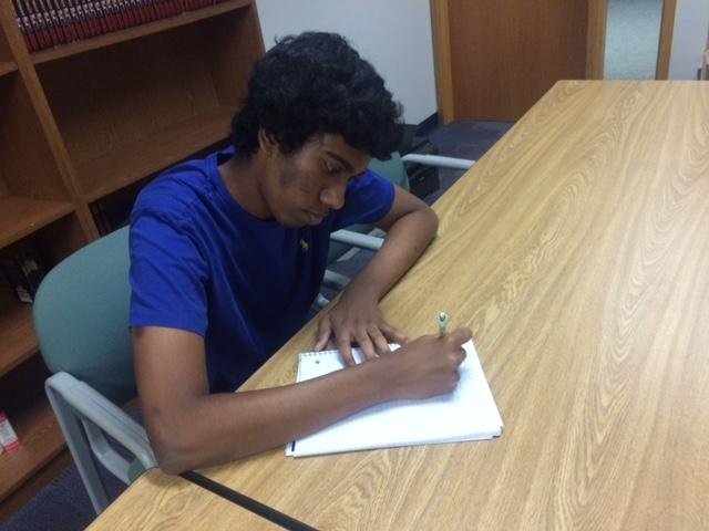 Planning for the upcoming Hands-On Education program, senior and club member Evin George starts scheduling for this event. This will be held on Oct. 23 from 4 to 6 p.m. at the Edna Martin Christian Center. DARRELL CHENG / PHOTO