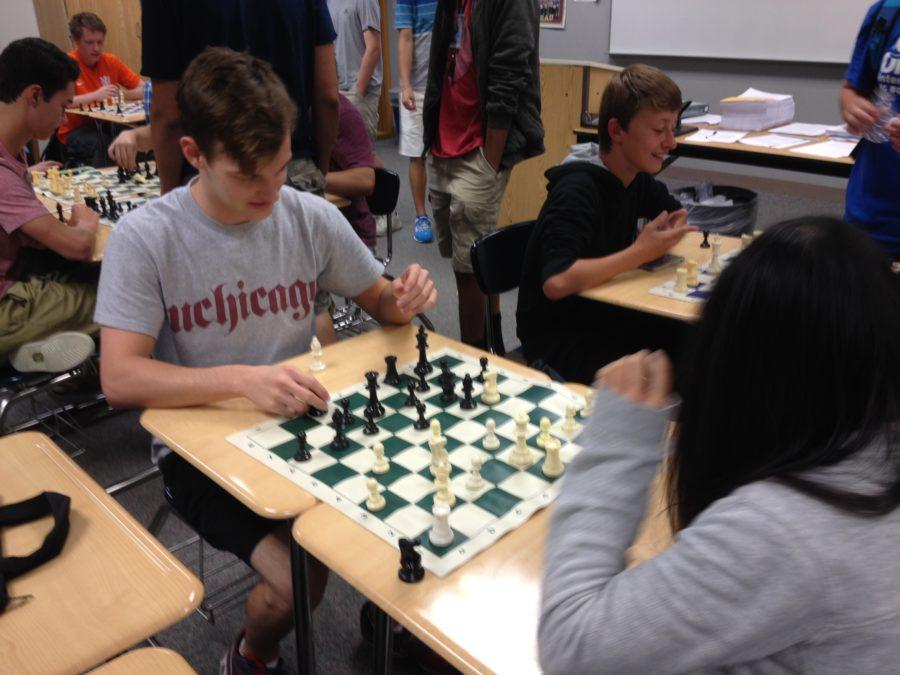 Joe Philleo, club co-president and senior, and club member Natalie Rumreich compete in a game of chess. This was Chess Club's third meeting. TERESA CHEN / PHOTO