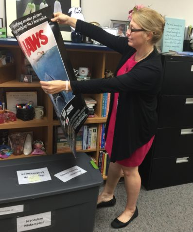 Club sponsor, Theresa Ramos, observes her movie poster for her next event. She had that available for House of Books members to give their opinion on how they want it to be displayed.