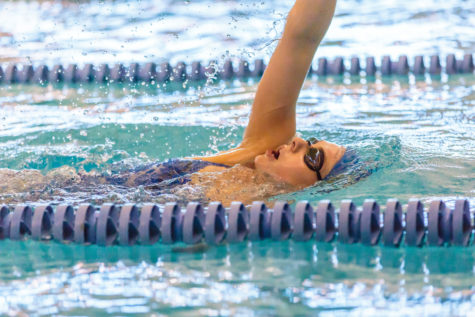 SWIMMING THE DISTANCE: Senior Claire Adams continues to set records