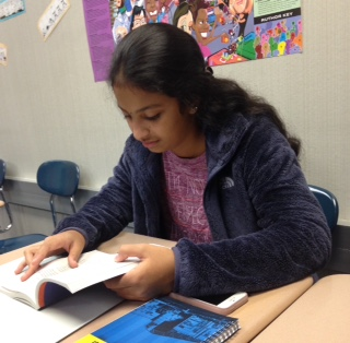 While waiting for the bell to ring, sophomore Hanisha Battina reads The Great Gatsby. Battina believes that the PTO is an important part of CHS and anyone interested in the PTO should attend the upcoming meeting on Oct. 6. Tweet: The PTO will hold their next meeting on Oct. 6 in the community room at 9 a.m.