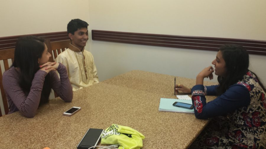 The three club members: Aryman Gupta, ISA club president and senior, ISA officer and senior Mariam Bari and ISA officer and junior Alina Hussain have a meeting after school at the library. PHOTO/ ANNIKA WOLFF