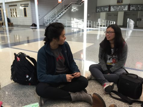 Carly Chia (right), Typography and Design Club's vice president and sophomore, talks to senior Jackie Hu (right) after school in the main commons. Chia said she looks forward to creating an Etsy store with the club's members in the future. PHOTO/ JASMINE LAM