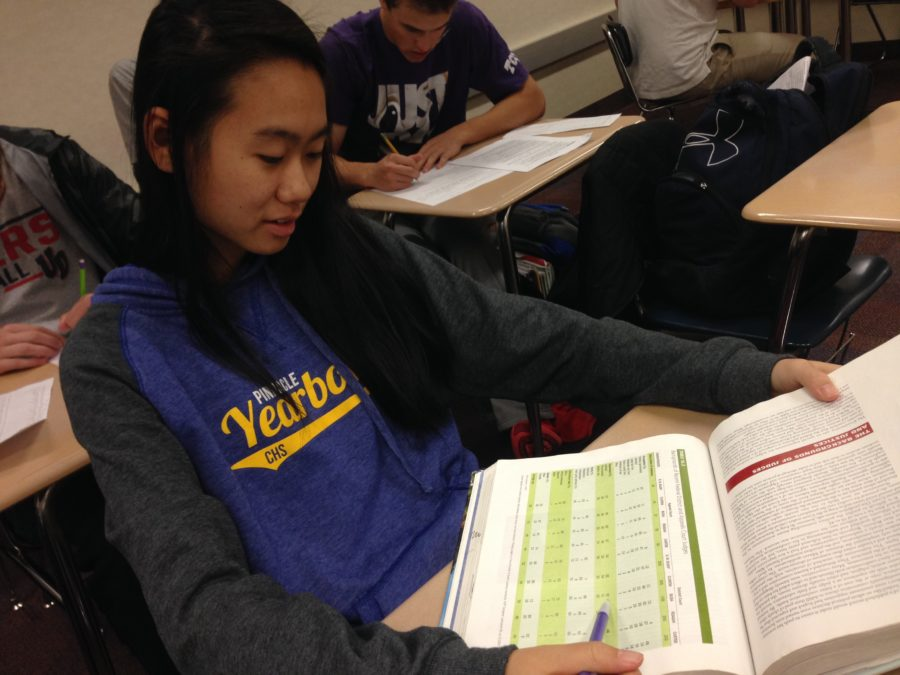 Kathryn Lin, National Merit Semifinalist and senior, reads her government textbook in AP Government. Lin said being recognized at the Oct. 26 board meeting was an honor.