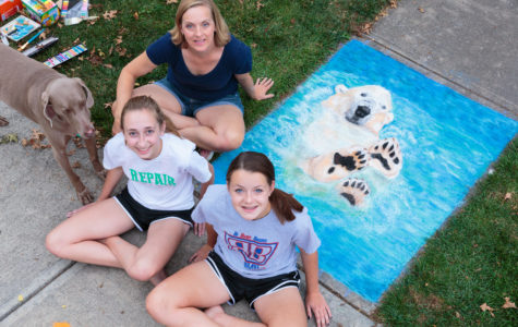 ART ON THE SIDEWALK: Senior Kate Bruns and freshman Claire Bruns are a family of chalk artists