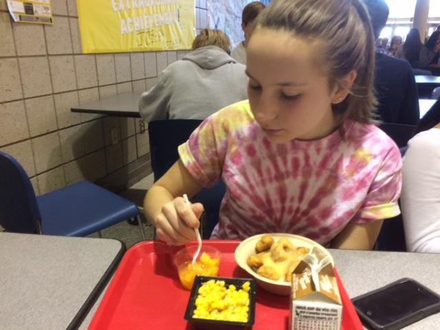 Chloe Wise, freshman and Sinfonia Orchestra member, eats her lunch after orchestra class. Wise said she looks forward to the upcoming Winter Concert after Thanksgiving break.