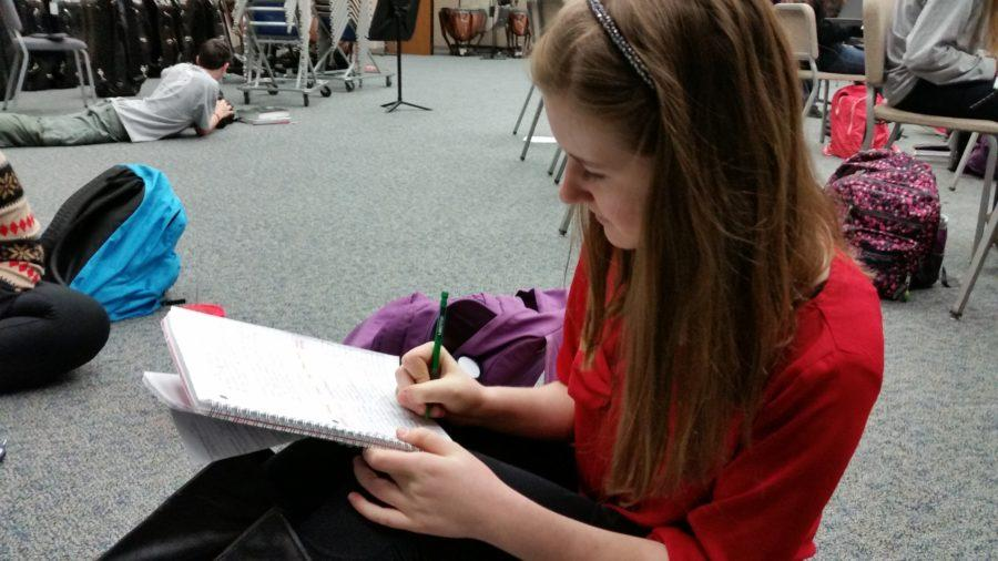 Grace Miller, Living Hope Club president and senior, works on her homework during SRT. She said club members will plan for the semester at the next meeting. PHOTO/ DEEPTHI THADASINA