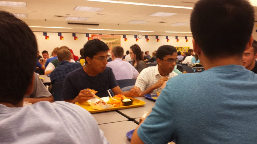 Aryaman Gupta, ISA club president and senior, sits with friends at lunch. PHOTO/ ANNIKA WOLFF