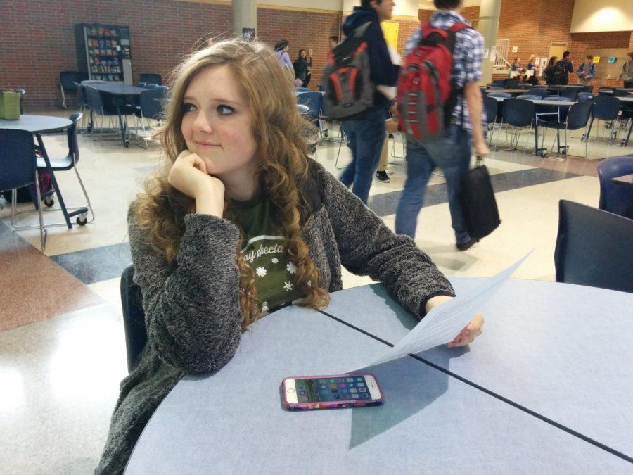 Dana Meinen, Key Club member and junior, listens to announcements at a club meeting. For this semester, the club plans to increase meeting attendance by offering more volunteer opportunities.
