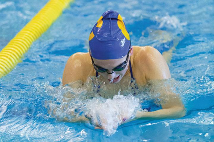 NOT A STROKE OF LUCK:  Senior Claire Adams  practices her breast stroke during practice. Adams  will be a member of the state team hoping to break the national record  for the most consecutive state titles with its 30th consecutive state win.  KYLE CRAWFORD // PHOTO