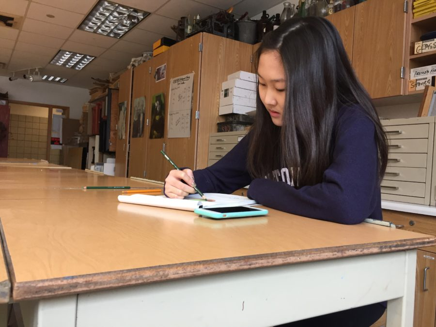 Junior Amy Kim works on a project for her Drawing 2 class. She hopes to be featured in one of the many art shows this semester. LILLY ST. ANGELO / PHOTO