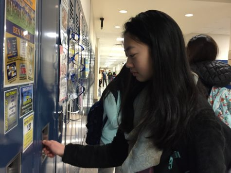 Chelsea Dai, president of Typography and Design Club and sophomore, opens her locker. She said this fundraiser is a good idea because it targets a charity that does not receive as much attention. CHELSEA DAI// PHOTO
