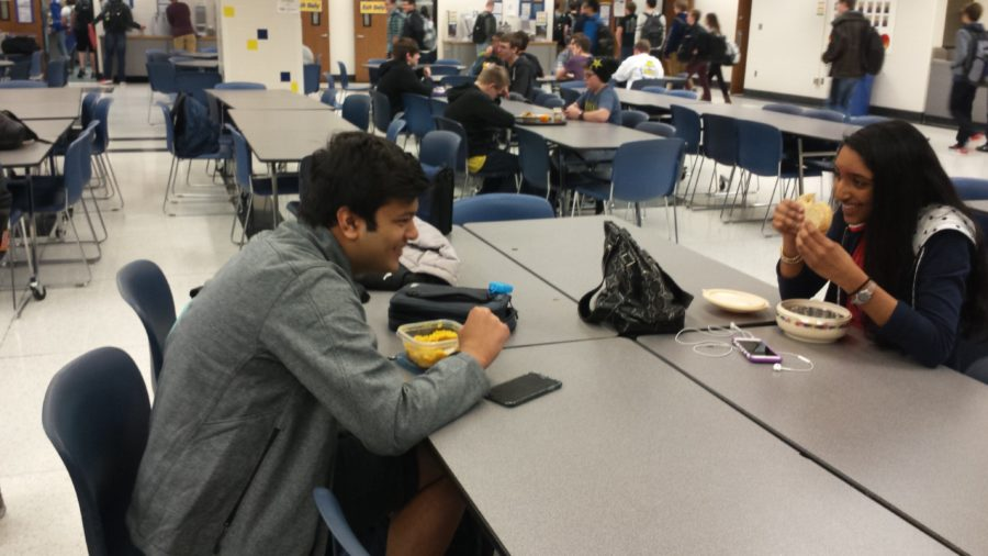 Secretary and sophomore Jai Sanghani and vice president and junior Sitha Vallabhanen eat during lunch while discussing ideas about the club. PHOTO// ANNIKA WOLFF