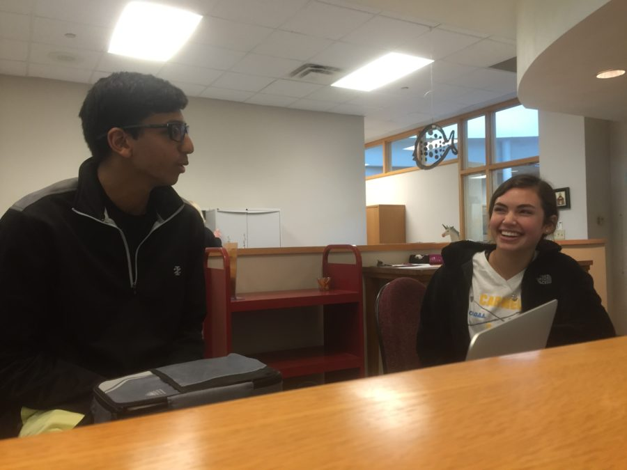 Senior senators Neil Shah and Molly Frank discuss NCAA March Madness over lunch on March 15. Shah said senate members are organizing a March Madness bracket competition that any SRT can participate in. PHOTO // EMMA LOVE