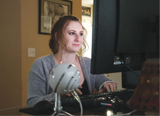"""NOT JUST A GAME: Senior Morgan Strohm watches a video game on her computer. According to her, there is a social disconnect between women  who game and those who label themselves as """"gamers."""" CAROLYN ZHANG // PHOTO"""