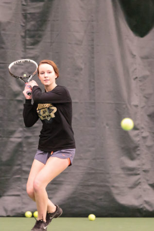 WARMING UP: Zoe Woods, varsity tennis player and junior, practices at Carmel Raquet Club. Woods and her teammates have been working hard to get back in shape for their potentially history-making season. KYLE CRAWFORD // PHOTO