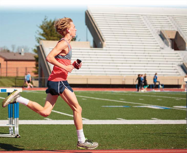 KEEPING UP  THE PACE: Senior Ben Veatch runs along the track at practice. Veatch said he believes that, due to their hard work, the team will reach state and receive deserved recognition for their efforts.  KYLE CRAWFORD // PHOTO