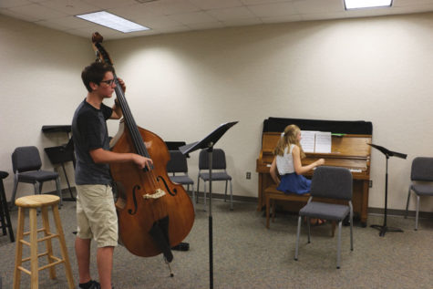 Freshman Will Rice plays the upright bass at practice during SRT.