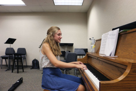 Junior Emma Hedrick plays the piano during the combo's practice.