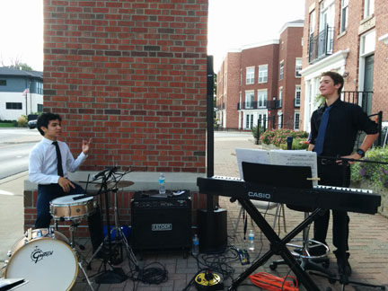 "At Porchfest on Sept. 10, Luke Belcher and William ""Will"" Rice, Main Street Jazz Band members and freshmen, prepare to play a song. According to Nancy Heck, Carmel director of community relations and economic development, many more arts festivals will take place in the Arts and Design District throughout September, like the International Arts Festival on Sept. 24 and 25."