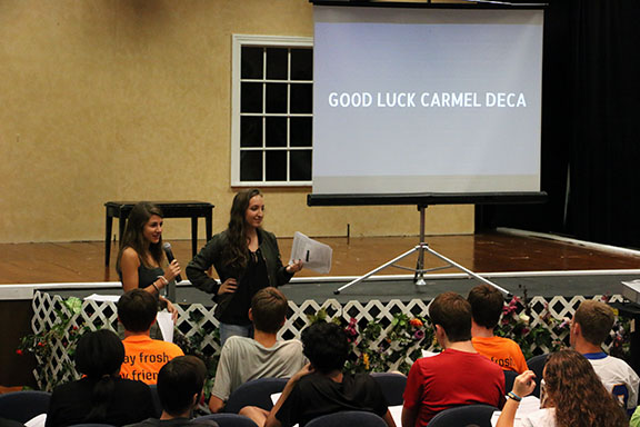 DECA DETAILS: Kathryn Scott and Isabelle Connell, DECA members and seniors, hold a meeting for DECA on Friday, Sept. 16 during SRT in the Studio Theater. Scott and Connell went over important details about Carmel DECA.