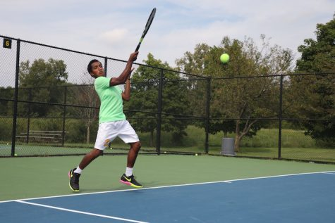 Nikhil Palde, JV player and sophomore, is warming up at practice. The boy's tennis team is hosting and looking to win their Sectional at the Todd Witsken Tennis Center on Sept. 28, 29, and Oct. 1.
