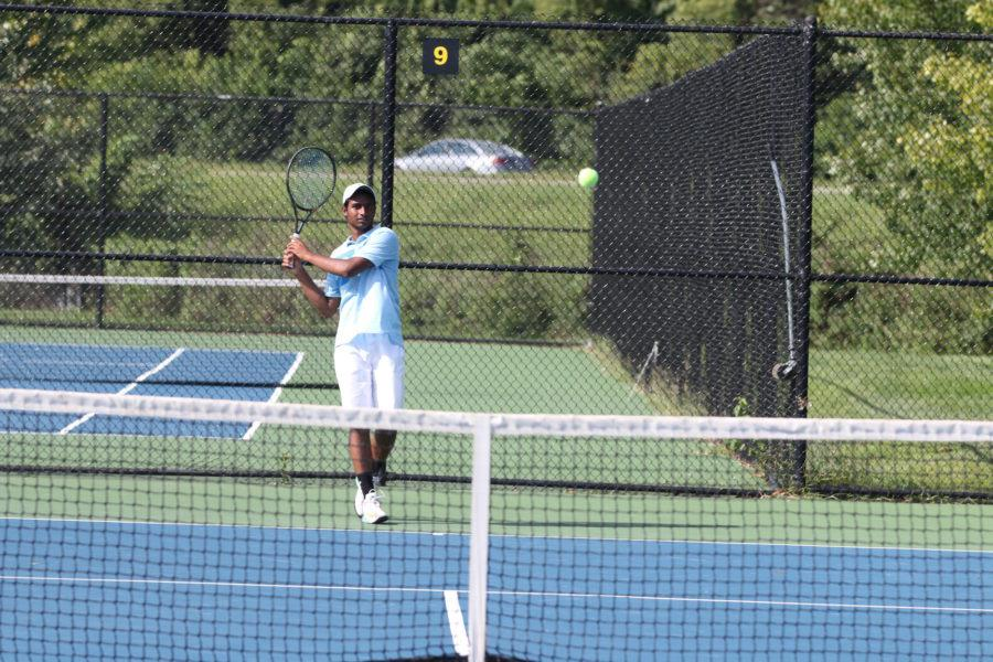 Rohit Nagaraj, JV player and senior, is warming up before a match against Cathedral. The boy's tennis team is looking to gain a State Championship title this season after being runner-ups for the last three years to North Central.