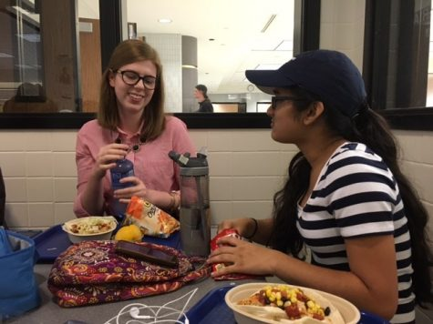 Junior Kendall Fahey (left) talks with junior Anika Bhargava (right) about their Homecoming party at lunch. According to Fahey, although the dance is mainly for freshmen and sophomores, there are alternative ways that upperclassmen can celebrate Homecoming.