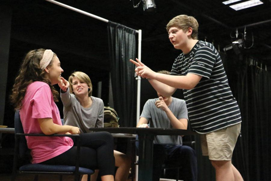 "Director and senior Tanner Chaille leads cast member and senior Maggie O'Scanaill. Chaille will be directing ""The Mysterious Act of Critique"" in the Studio One Acts."