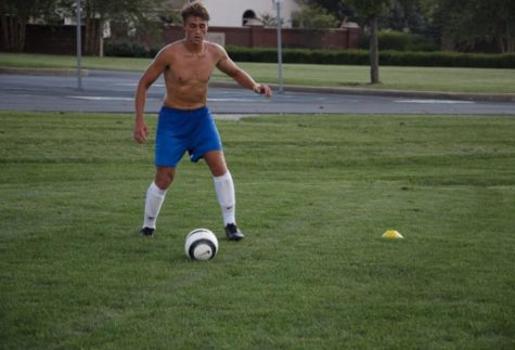 Ethan Abbott, soccer player and senior, participates in a scrimmage during practice. The team frequently does scrimmages to prepare for games and build their communication skills.