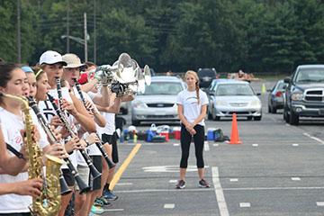 Marching to her Own Beat (Q&A): Caroline Heyl is the only sophomore drum major in marching band this year