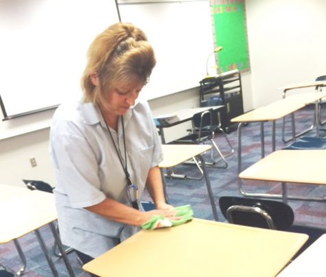 CHS custodian Susie Denson doing what she does best in Family Consumer Science room after school.