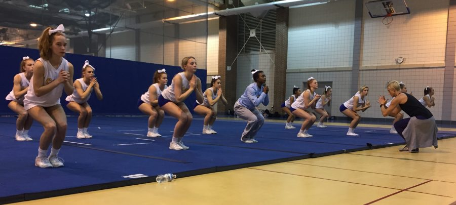 Coach Voris leads the cheerleading team in various stretching exercises before they start practice. The exercises challenges the girls to stretch in a different way from their typical before practice stretching.
